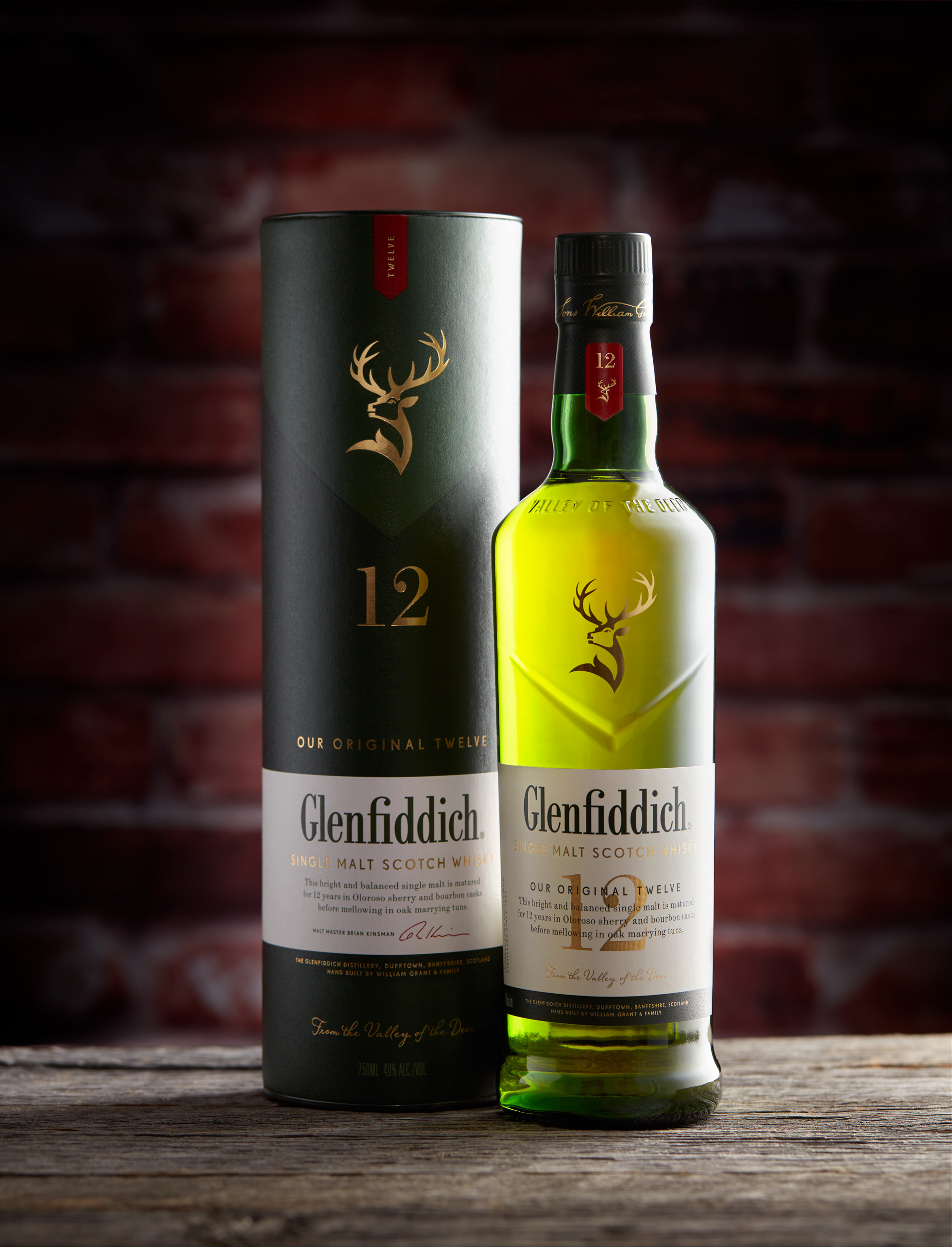 Studio product photo of a Glenfiddich Scotch Whiskey bottle and packaging.