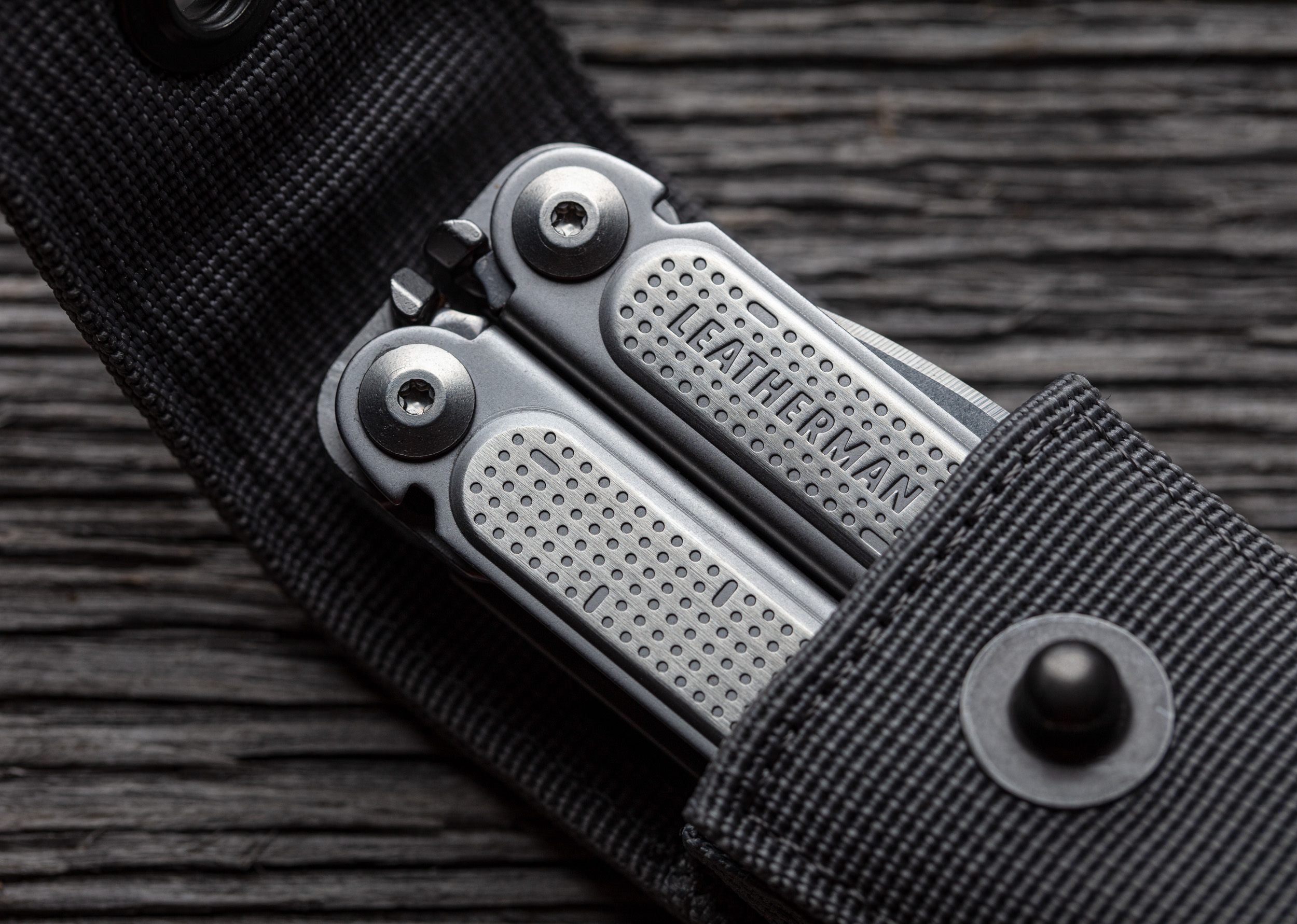 Product photograph of a Leatherman multi tool on wood background