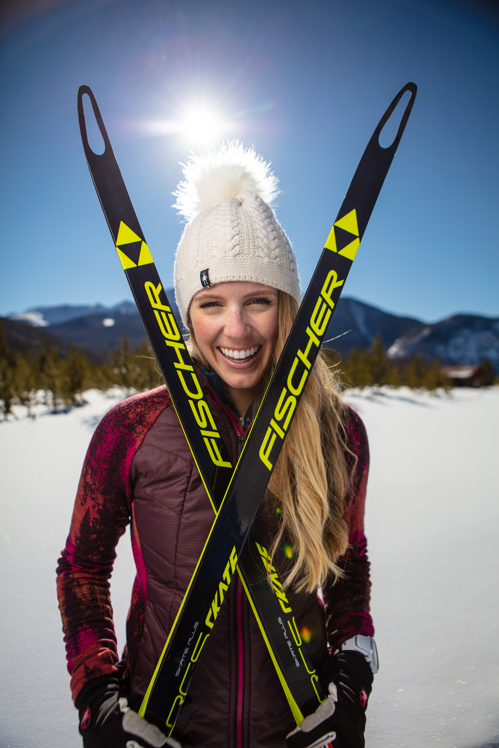 Portrait of female Nordic Cross Country Skate Skier with Fischer skis