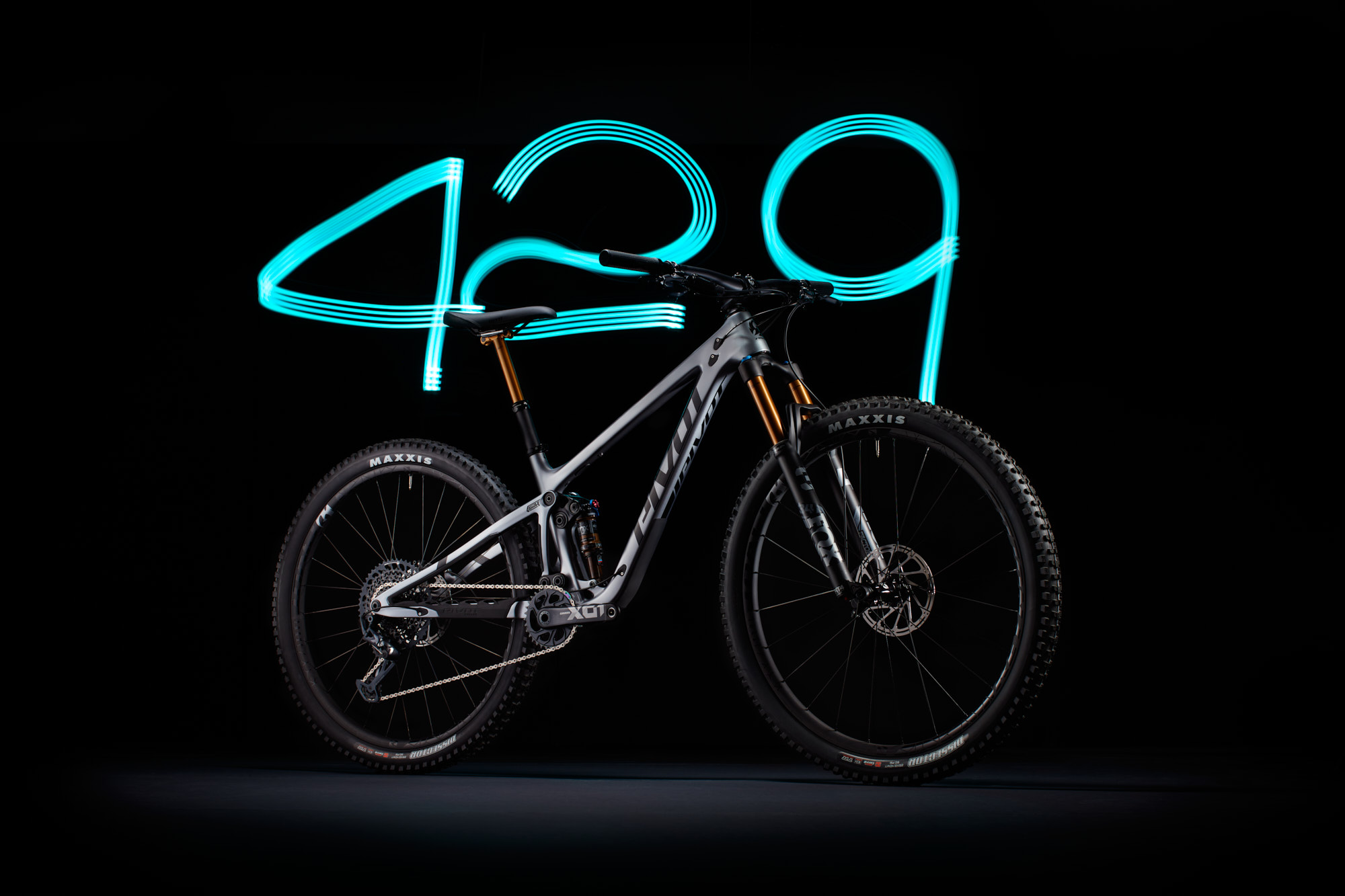Pivot 429 Trail mountain bike in light painting long exposure in high end studio product photo.