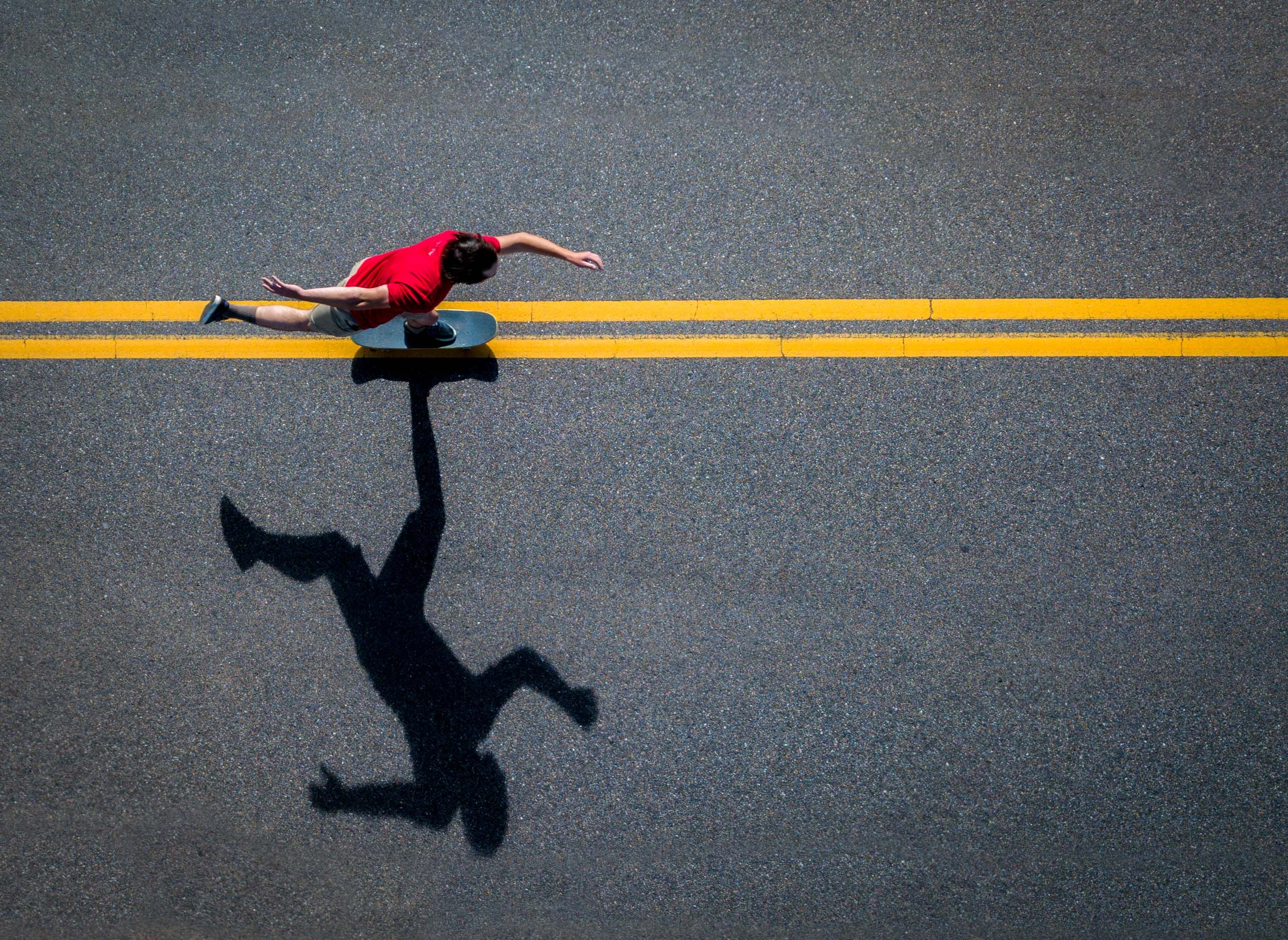 Aerial lifestyle photography of a skateboarder on a road in Boulder, Colorado
