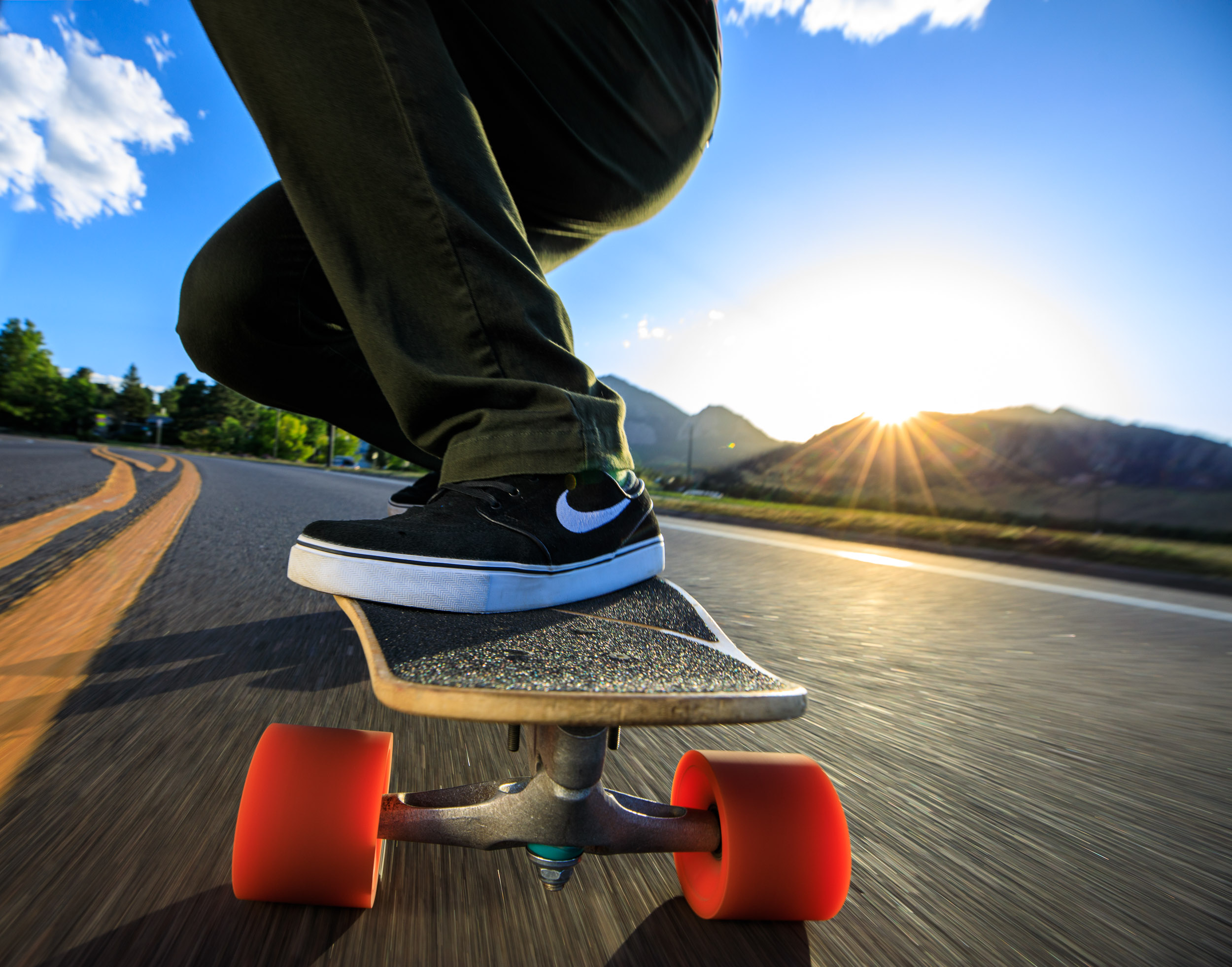 Lifestyle photograph of  guy skateboarding with Nike SB shoes in Boulder Colorado