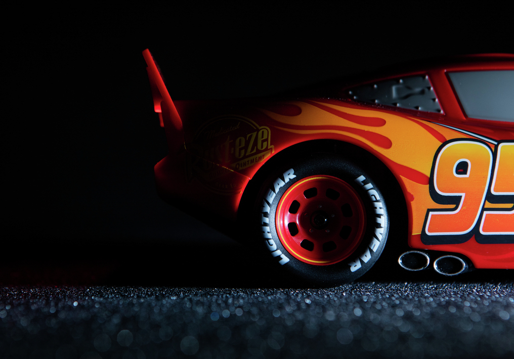Lightning Mcqueen by Sphero app controlled robotic toy on black background.