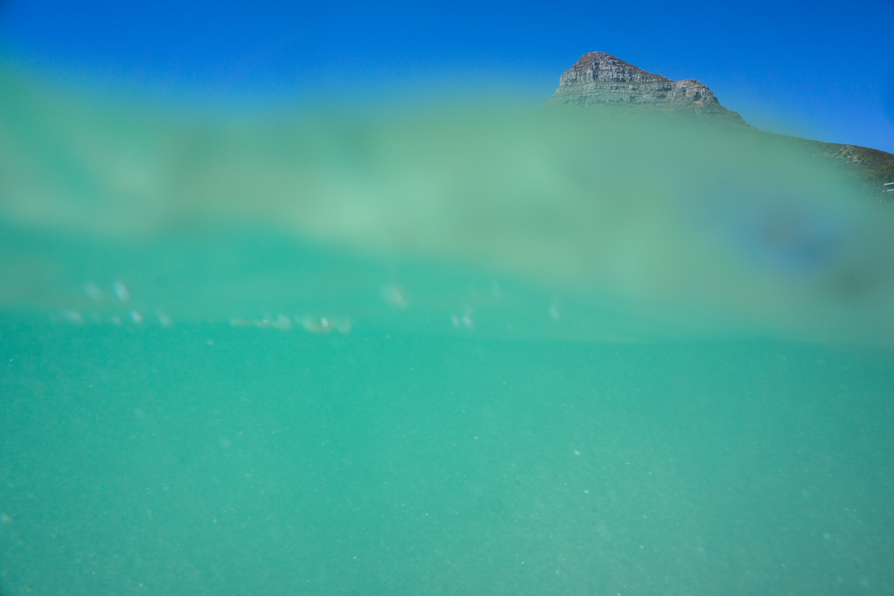 Lionshead mountain seen partially from underwater in Cape Town, South Africa.