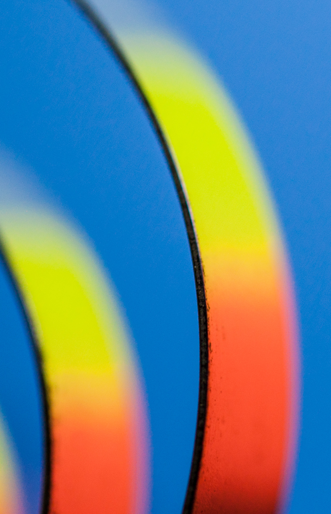 Macro Fine Art photo of color reflecting on steel bands.