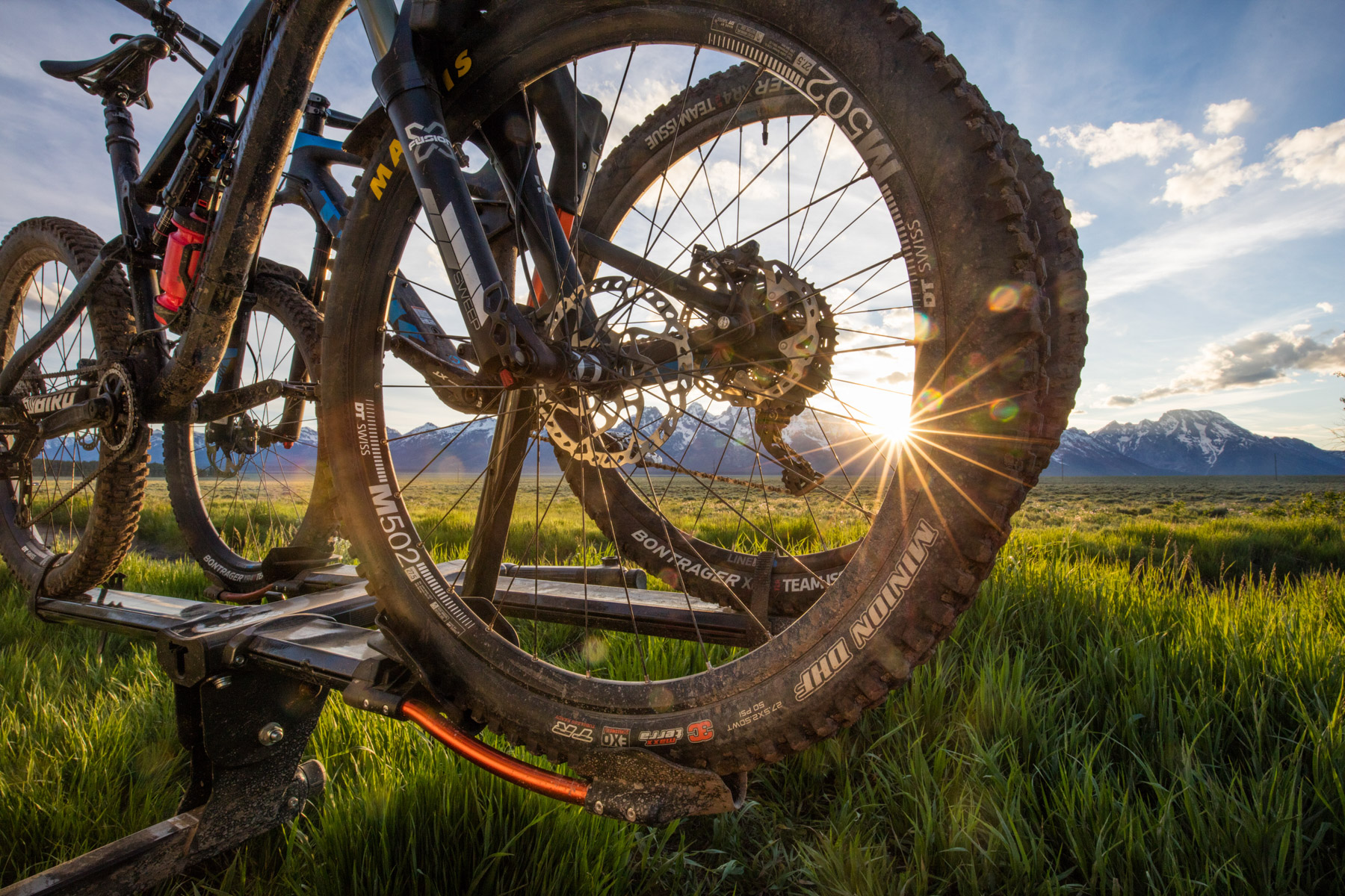 Product photo of Kuat bike racks with sunburst in Teton National Park, Wyoming.
