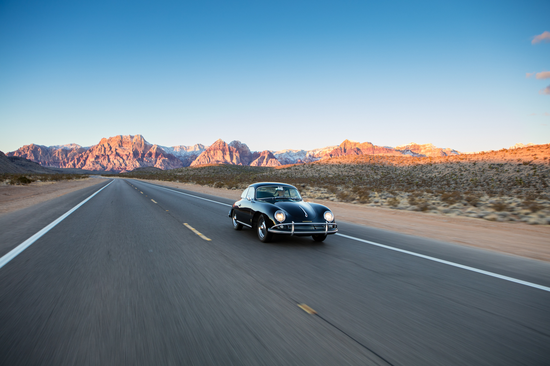Lifestyle action photo of classic vintage Porsche driving in Red Rocks, Nevada.