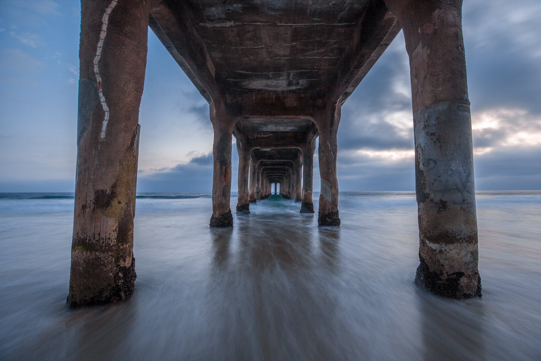 Long Exposure underneath Manhattan beach pier in California.