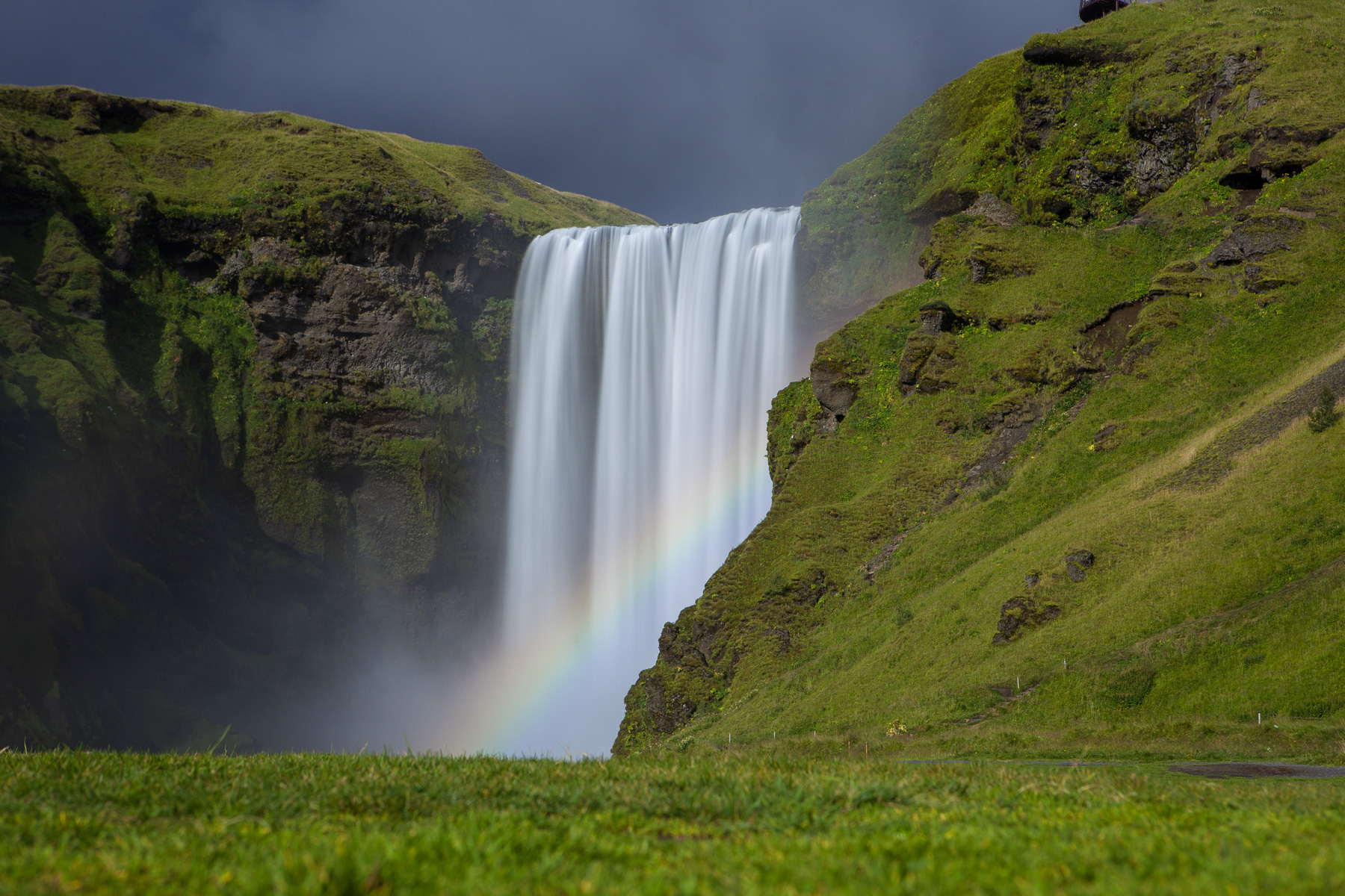 Long Exposure of Skogafoss waterfall with rainbow in Iceland.