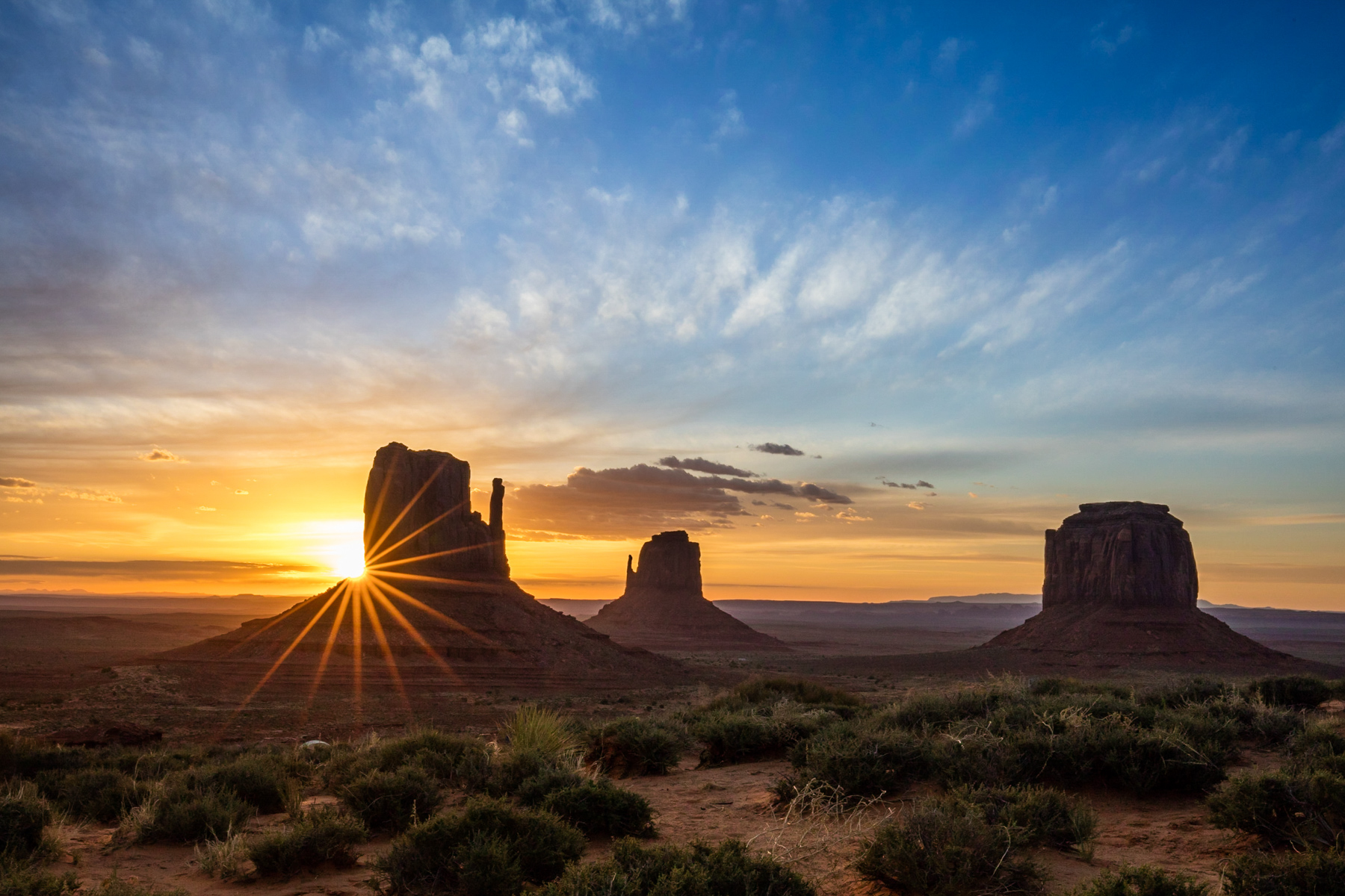 Sunrise with sunburst in Monument Valley, Utah.