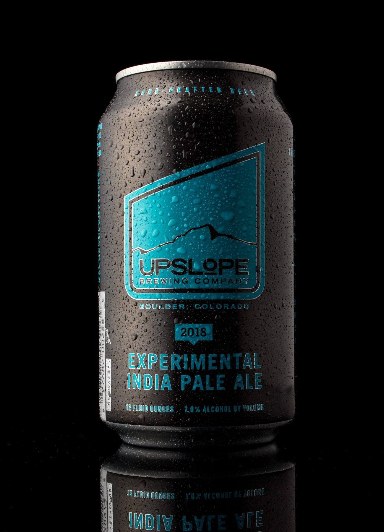 Uplsope brewing IPA craft beer can with condensation product photo on black background.