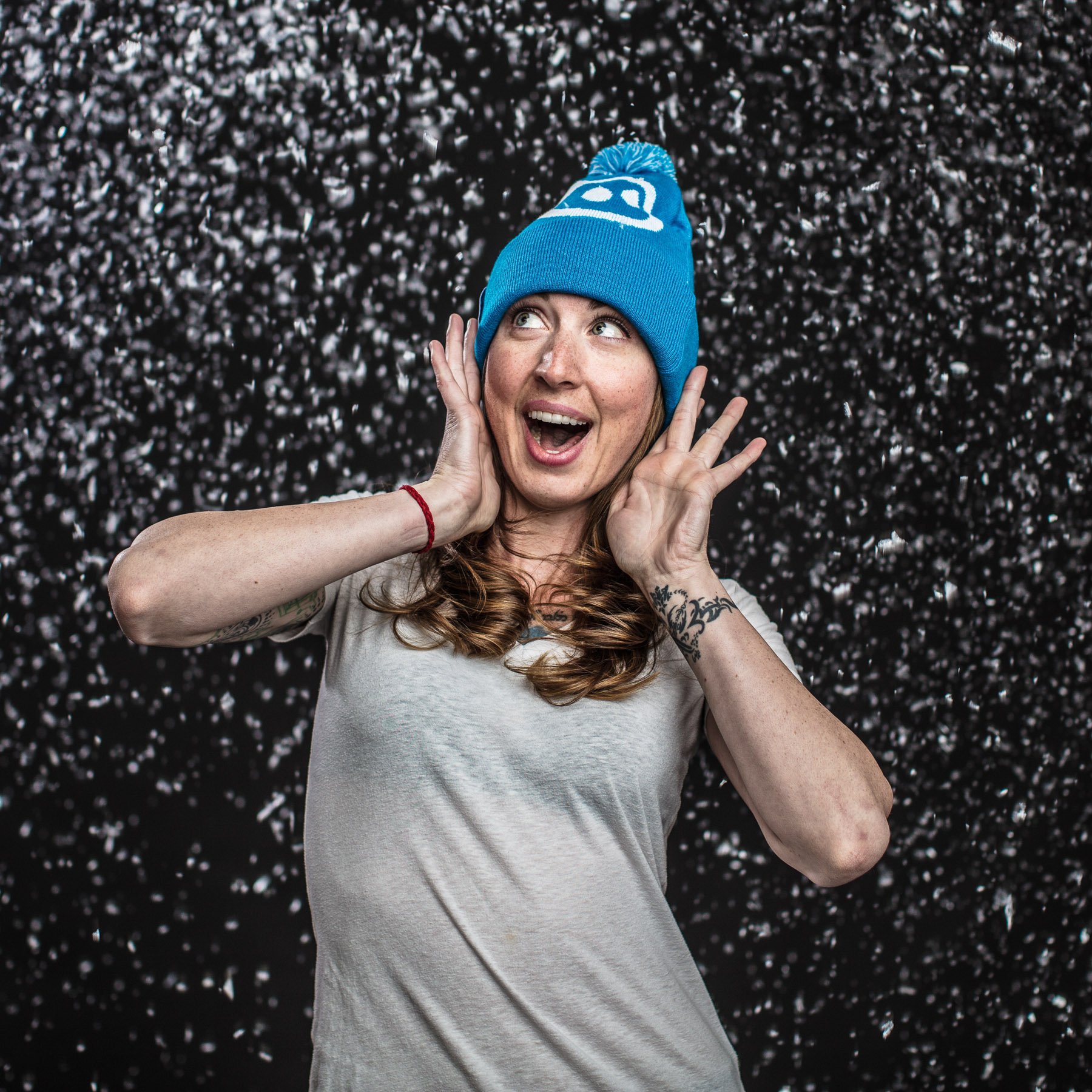 "Studio fashion portrait of girl in the ""snow"" with beanie on in Boulder, Colorado."