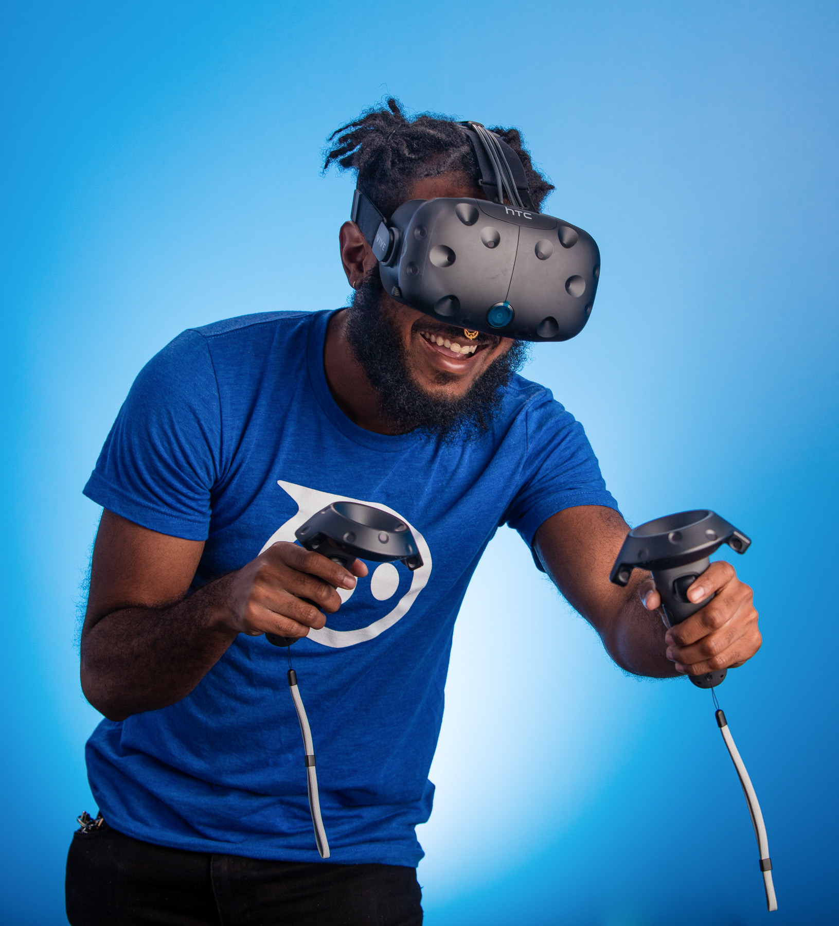 Studio portrait of man playing on Oculus Rift in Boulder, Colorado.